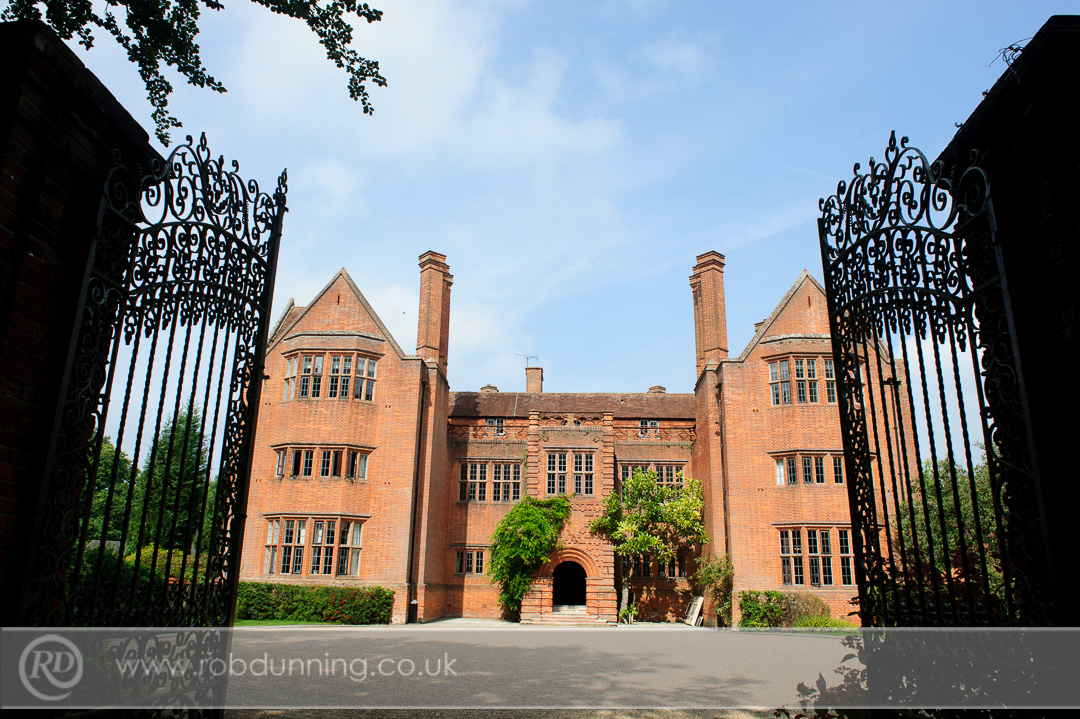 Tall iron gates outside of the manor house New Place Wedding Photography